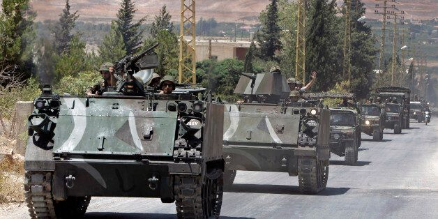 Lebanese army reinforcements arrive to the outskirts of Arsal, a predominantly Sunni Muslim town near the Syrian border in ea