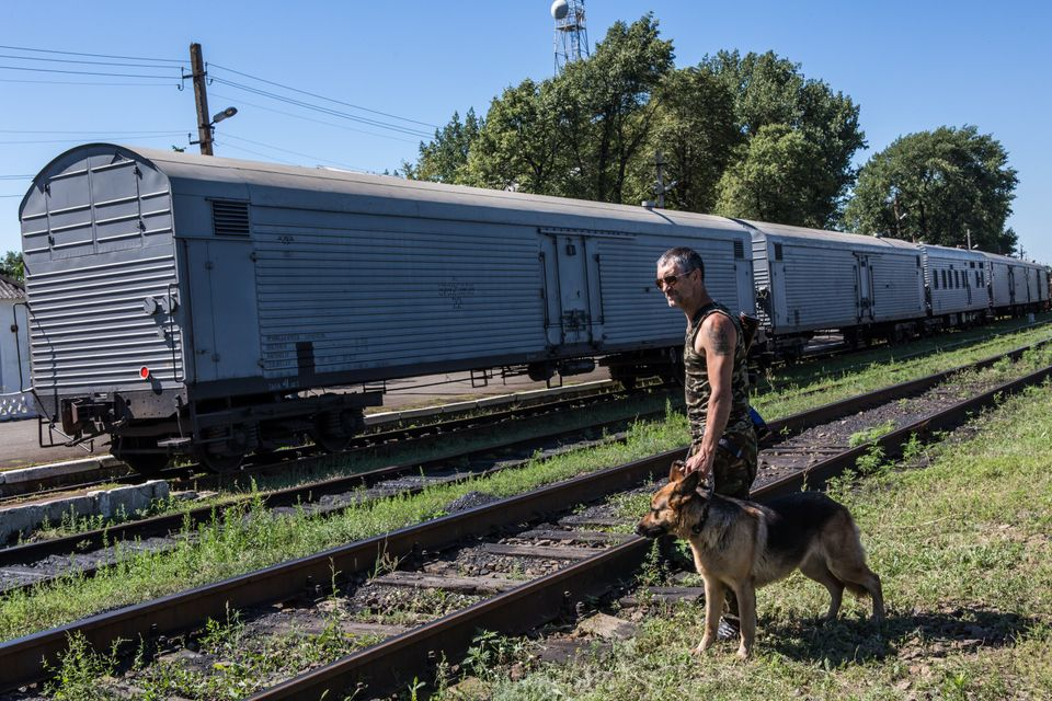 A pro-Russia rebel guards a train containing the bodies of victims of the Malaysia Airlines flight MH 17 crash on July 21, 20
