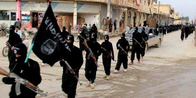 FILE - This undated file image posted on a militant website on Tuesday, Jan. 14, 2014 shows fighters from the al-Qaida-linked