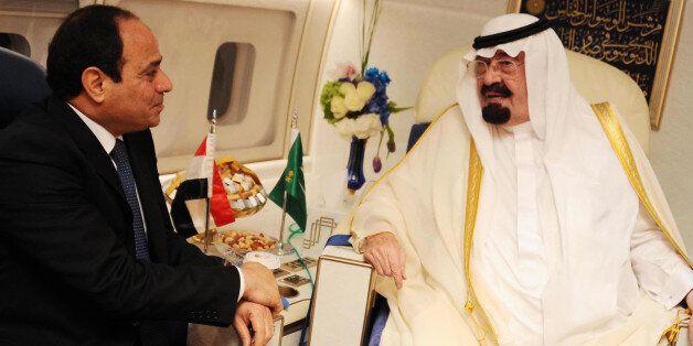 CAIRO, EGYPT - JUNE 20: Saudi King Abdullah bin Abdulaziz (R) and Egyptian President Abdel-Fattah al-Sisi (L) meet on board t