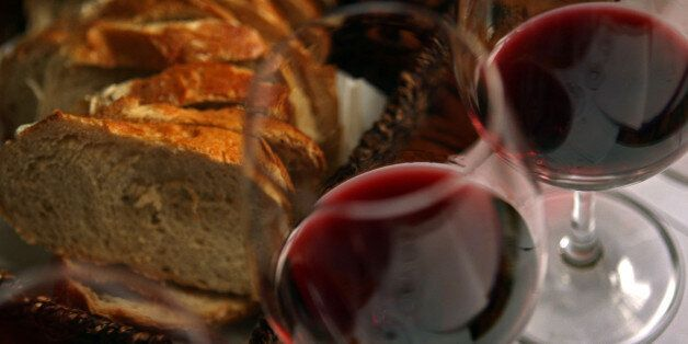TEL AVIV, ISRAEL - MARCH 25:  Fresh country bread and red wine are served with lunch at the Carmella Banahela bistro on March