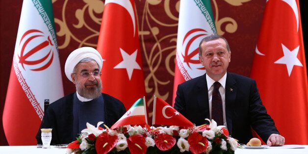 ANKARA, TURKEY - JUNE 9: Turkish Prime Minister Recep Tayyip Erdogan (R) meets with Iranian President Hasan Rouhani (L) at Ankara Palace during business lunch on June 9, 2014 in Ankara, Turkey. (Photo by Kayhan Ozer/Anadolu Agency/Getty Images)