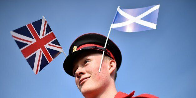 A member of the Grand Orange Lodge of Scotland prepares ahead of a march in Edinburgh, on September 13, 2014.  Thousands of m