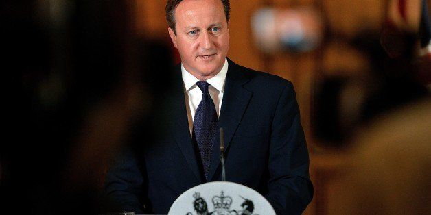 Prime Minister David Cameron makes a statement to the media at Number 10 Downing street in London on September 14, 2014 on th