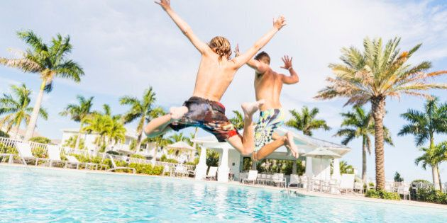 USA, Florida, Jupiter, Boy (8-9) diving into swimming pool with his