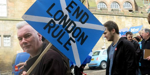FILE - In this March 15, 2014 file photo, a demonstrator carries a sign during a pro-independence march in Edinburgh, Scotlan