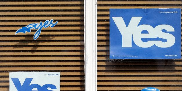 A Yes poster displayed a house window in East Barnes, Scotland, Tuesday, Sept. 16, 2014. The two sides in Scotland's independ