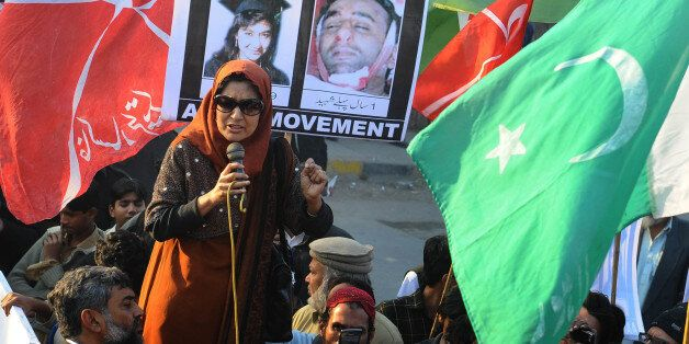 Fauzia Siddiqui, sister of Aafia Siddiqui who is being sentenced to 86 years in prison for trying to shoot US military officers, leads a protest in front of the US Consulate in Lahore on January 29, 2012. Siddiqui was sentenced to 86 years in jail by a US court who found her guilty of the attempted murder of US military officers in Afghanistan in 2008. AFP PHOTO/Arif ALI (Photo credit should read Arif Ali/AFP/Getty Images)