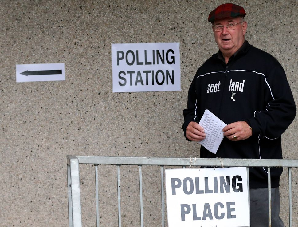 A man arrives to cast his ballot at Ritchie Hall in Strichen, Scotland, Sept. 18, 2014.