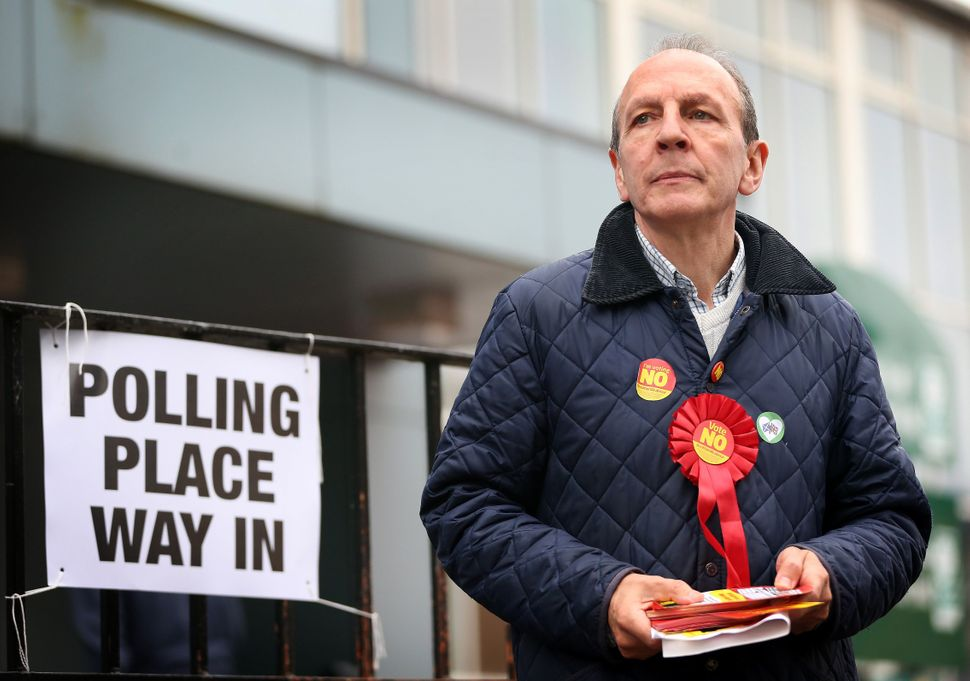 A pro-union campaigner waits to distribute leaflets to voters at a polling station in west Glasgow, Scotland, on polling day