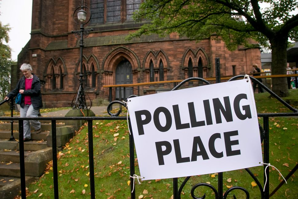 Voters leave a polling place in Morningside, Edinburgh on Sept. 18, 2014.