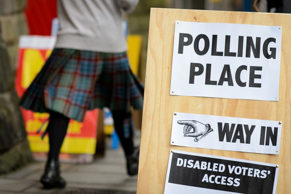 Voters walk outside a polling station in Edinburgh on Sept. 18, 2014, during Scotland's independence referendum.