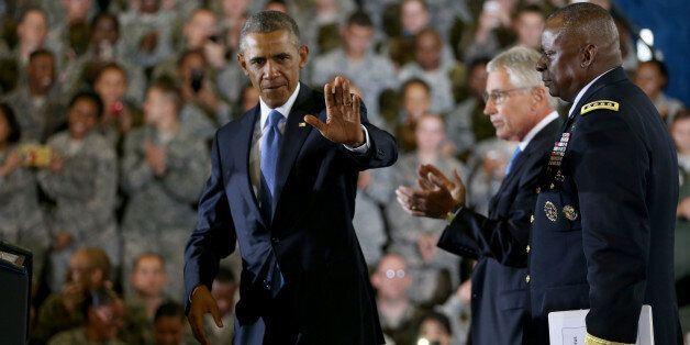 TAMPA, FL - SEPTEMBER 17:  U.S. President Barack Obama waves as he arrives on stage to speak during a visit to the U.S. Centr