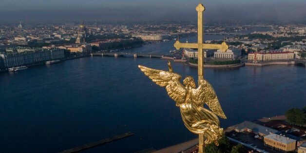 In this aerial photo the city landmark, a gilded weather vane in the form of an angel, fixed atop a spire of the Saints Peter