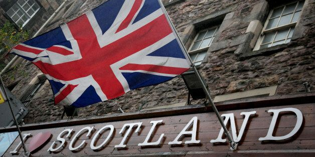 EDINBURGH, SCOTLAND - SEPTEMBER 19:  The Union Flag flies above a gift shop in central Edinburgh on September 19, 2014 in Edi