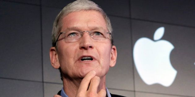 FILE - In this April 30, 2015 file photo, Apple CEO Tim Cook responds to a question during a news conference...