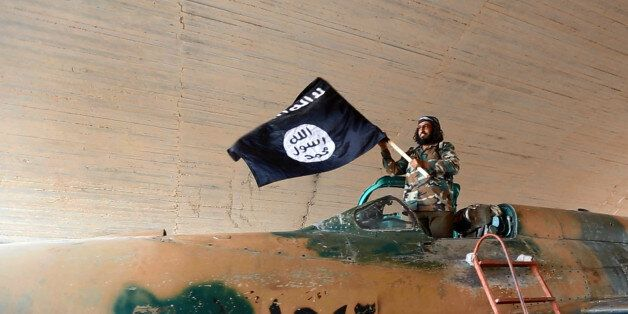 This undated image posted on Wednesday, Aug. 27, 2014 by the Raqqa Media Center of the Islamic State group, a Syrian oppositi