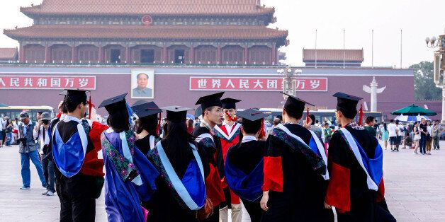 BEIJING, CHINA - 2014/06/19: Graduates from Peking Union Medical College take commemorative photos in Tienanmen Square. In 20