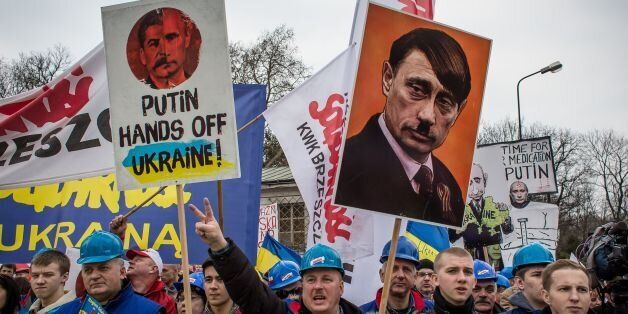 Members of Polish trade union 'Solidarity' demonstrate with placards reading 'Putin, hands off Ukraine!' for a democratic and