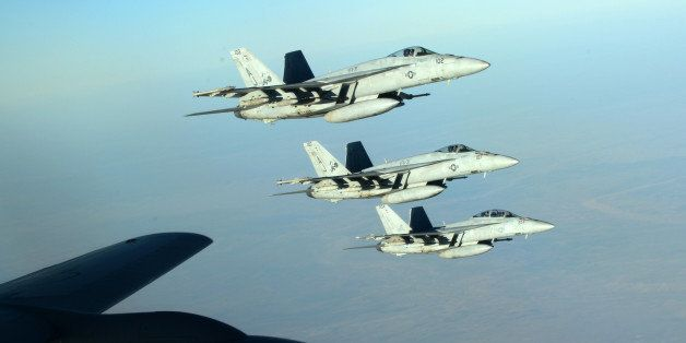 In this Tuesday, Sept. 23, 2014 photo released by the U.S. Air Force, a formation of U.S. Navy F-18E Super Hornets leaves aft