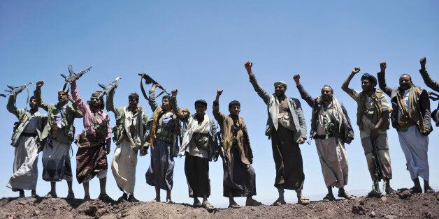 Hawthi Shiite rebels chant slogans at the compound of the army's First Armored Division, after they took it over, in Sanaa, Y