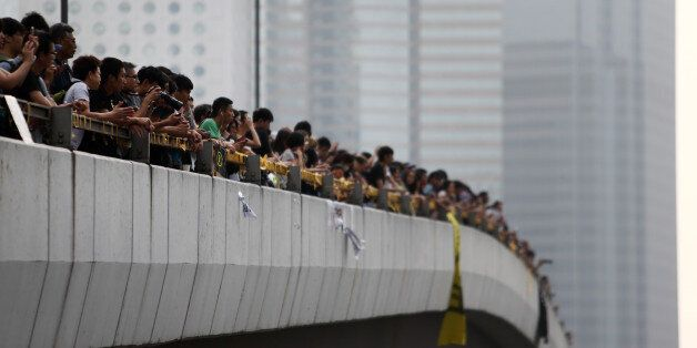 Demonstrators on an elevated road look at the office of Hong Kong's chief executive Leung Chun-ying in Hong Kong, China, on T