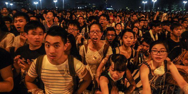 HONG KONG - OCTOBER 2: Pro-democracy protesters chant slogans outside of Hong Kong's Chief Executive C.Y. Leung's office on O