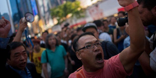 HONG KONG - OCTOBER 03:  Anti-Occupy supporters chant at the Occupy camp in Causeway Bay on October 3, 2014 in Hong Kong. Tho