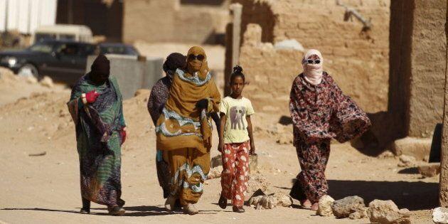 Indigenous Sahrawi women walk through Al Smara desert refugee camp in Tindouf, southern Algeria March...