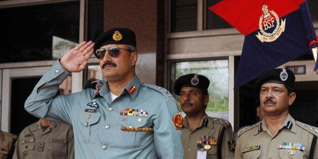 NEW DELHI, INDIA  - JULY 2: Director General of Pakistani Rangers (Sindh) Major General Rizwan Akhtar salutes during a guard