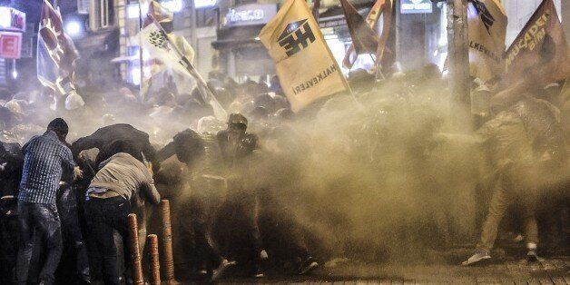 Police used tear gas and water cannon on October 7, 2014 in Istanbul against demonstrators who protest against attacks launch