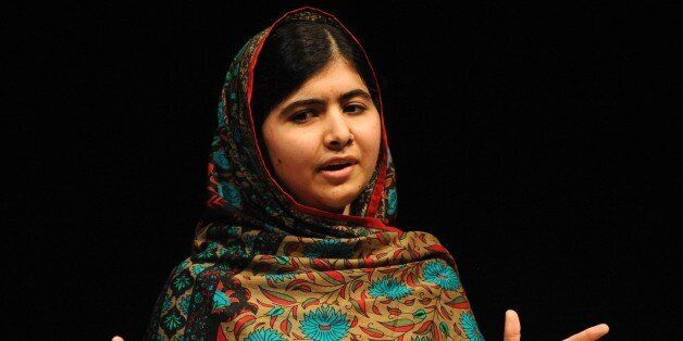 Malala Yousafzai speaks during a media conference at the Library of Birmingham, in Birmingham, England, Friday, Oct. 10, 2014