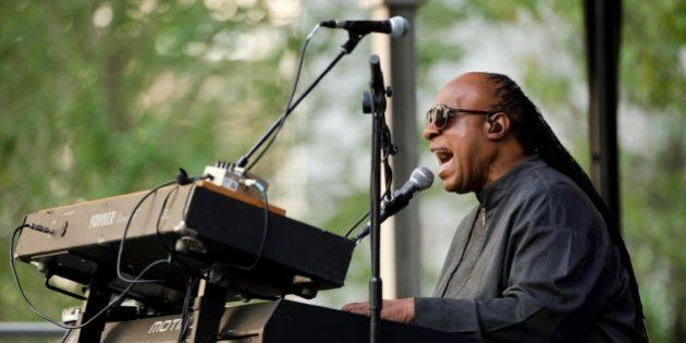 Musician Stevie Wonder performs during a free pop-up concert Monday, Aug. 17, 2015, outside City Hall...