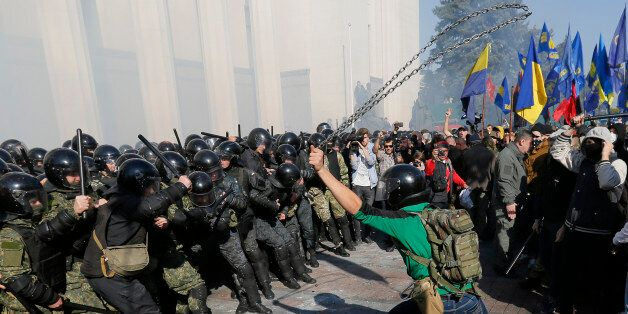 Police clash with rowdy demonstrators outside parliament in Kiev, Ukraine, on Tuesday, Oct. 14, 2014, as deputies repeatedly