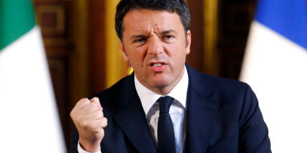 Italian Prime Minister Matteo Renzi clenches his fist as he delivers a speech at the Sorbonne University,...
