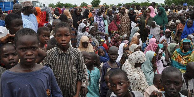 Civilians who fled their homes following an attack by Islamist militants in Bama, take refuge at a school in Maiduguri, Niger