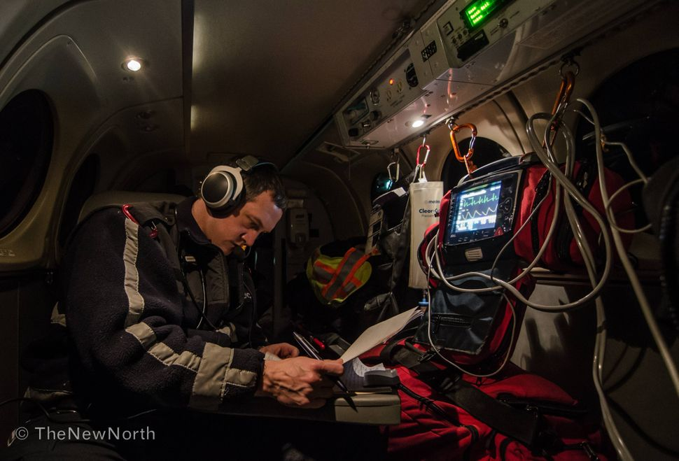 Charting on a late night medevac from Paulatuk NT to Inuvik NT.
