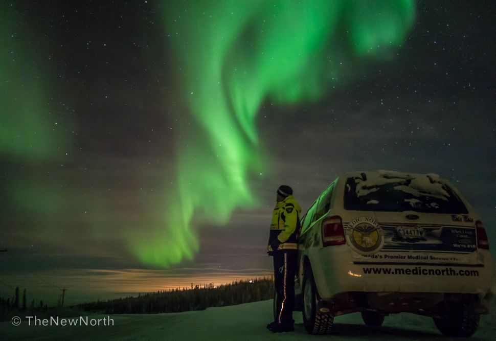 Driving back from the airport in Inuvik one night they were so amazing that I just had to stop at take it all in.