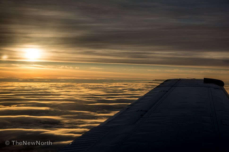 Heading north toward Cambridge Bay, with the sun setting to the west.