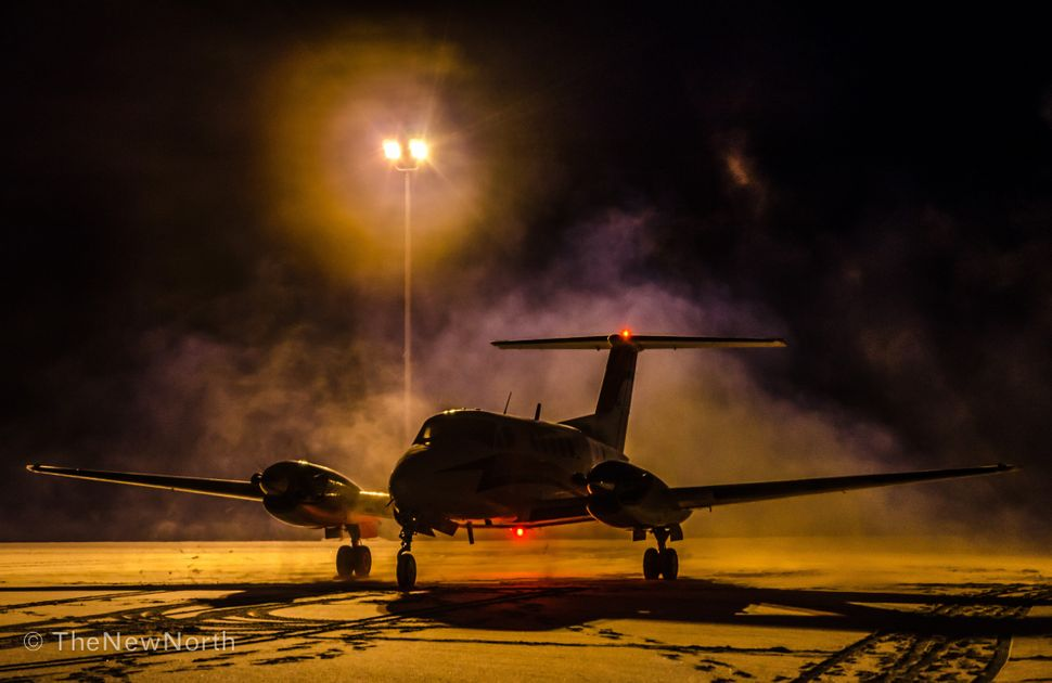 Our King Air in Inuvik, starting up for an early morning medevac.