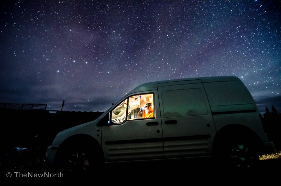 This is a selfie with the reflection of the northern lights in the van, and the big dipper above. Taken outside Yellowknife.
