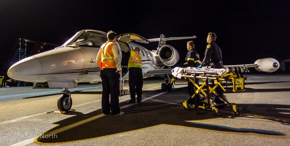 We are about to unload a patient from our LearJet at the Yellowknife airport.