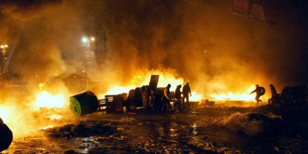 Kyiv, Ukraine - January 22, 2014: Unknown demonstrators fight with police in government district on January