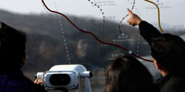Visitors look at a map of the demilitarized zone at the Imjingak Pavilion near the border village of Panmunjom in Paju, South