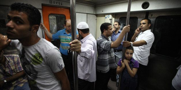 CAIRO, EGYPT - MAY 28:  Commuters travel on the  Metro on May 28, 2011 in Cairo, Egypt. Protests in January and February brou