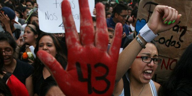 Demonstrators march in protest for the disappearance of 43 students from the Isidro Burgos rural teachers college, in Mexico