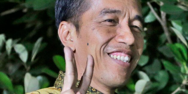 Indonesian President-elect Joko Widodo gestures during a press conference at his residence in Jakarta, Indonesia, Thursday, A