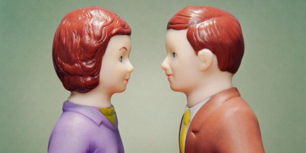 Husband and wife figurines facing each