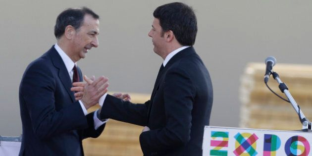 Italian Premier Matteo Renzi, right, greets Giuseppe Sala, Commissioner of Expo 2015, during his visit...