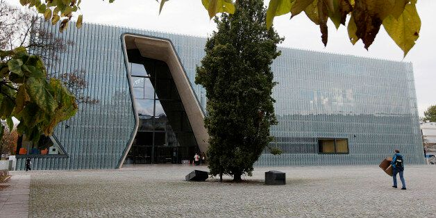 In this photo taken Tuesday, Oct. 21, 2014, a person walks outside the POLIN Museum of the History of Polish Jews in Warsaw,